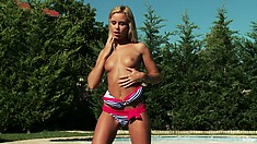A girl in sexy bikini walks in the swimming pool and returns naked out of there