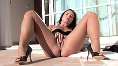 She lies back, spreads her sexy tanned legs and plays with her wet juicy pussy