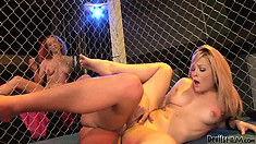 Redhead gets horny outside the ring masturbating and watching a blonde get fucked