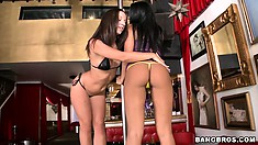 Two strippers with fine asses are dancing and getting some cunt licking