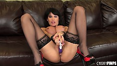 Eva Karera shoves a big dildo deep into her gaping pink gash
