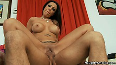 Amy Fisher rides his cock showing her big tits for the camera