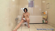 In the bathroom, the Asian babe sensually showers her slim body and her sweet cunt