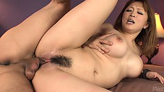 Busty Japanese cougar Yuki Touma gets spoon fucked while her lips please a hard dick