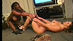 Horny ebony lesbians eat each other out during a vintage porno