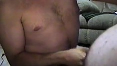 Chunky gay guy gets two guys' hot spunk all over his fat belly