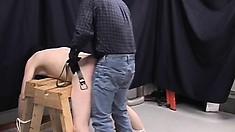 All tied up and bending over, a submissive guy gets his ass spanked hard