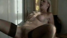Appetizing blonde whore in black stockings has her butt stretched