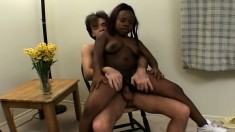 Black hottie Cinnamon jumps on top of a white stud and rides his prick
