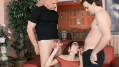 Redhead housewife Tabitha gets fucked by two studs and her man watches