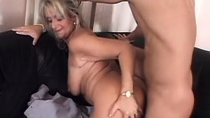 Mature blonde bitch puts her experience to work on a young man