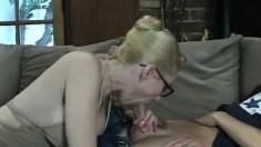 Stacked blonde mom sucks the young stud's cock and takes it deep in her wet snatch