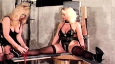 Busty blonde lets her submissive admirer lick the dirt off her high-heeled boots