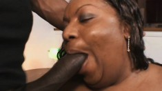 Chubby ebony lady with a massive booty feeds her hunger for black dick