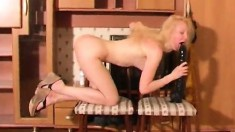 Petite blonde teen Lada reaches her climax with the help of a big toy