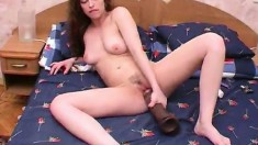 Linda makes her snatch all wet with the help of a huge black sex toy