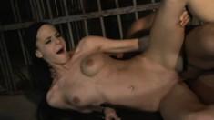Fascinating brunette Liz plays out her bondage fantasies behind bars
