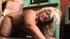 Chubby blonde milf has a young man's hard cock making her peach happy