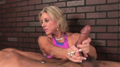 Kinky blonde cougar enjoys a cigarette and delivers a special handjob