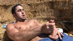 Sexy cowboy strips off his clothes and pleases himself under the sun