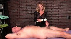 Horny Guy Lies On His Back And Gets His Cock Milked By A Hot Masseuse