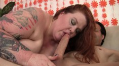 Older redhead gets horny and works a cock with her huge tits