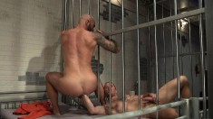 Two horny inmates take off their orange jumpsuits for some cocksucking and fist fucking