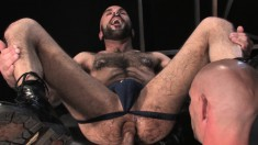 Hairy guy takes his lustful partner's fist deep in his juicy anal hole