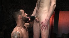 Provoking young boy has a tattooed guy deeply fisting his lovely ass