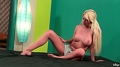 Busty blonfe hottie wants to have some fun and gets naked to play