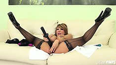 Ava Devine uses her pink dildo in her ass and the black one in her pussy