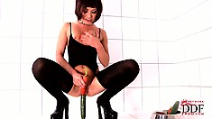 Brunette babe in latex stockings fucks herself with vegetables