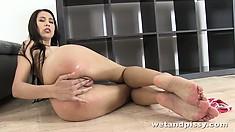 She fingers her holes then rolls back for a self golden shower
