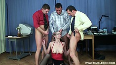 The horny secretary gets her holes banged hard and takes their cum on her face