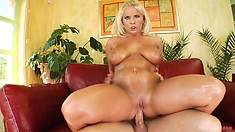 Lucy is oiled up and ready for action as she gets drilled in her tight MILF ass