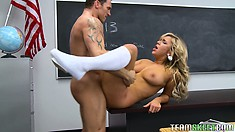 Hot blonde with divine tits and a heavenly ass gets fucked deep on the teacher's desk