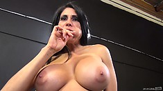 Sheila Maire shows off her sexy body while sucking her lollipop