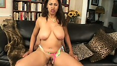 The busty babe enjoys a deep pounding doggy style before wildly riding his stiff cock