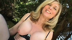 Lustful blonde milf in black lingerie sucks and fucks a big cock in the outdoors