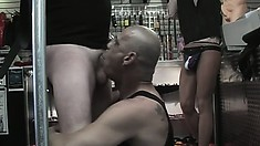 Dudes in the sex shop are licking ass and deep throating cock