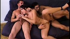 Horny brunette slut gets her holes taken up by massive cocks