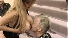 Older guys enjoying the oral skills of a hot sex-frenzied blondie