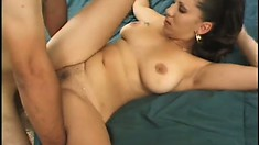 Buxom Latina Alexxis plays with a sex toy before enjoying two big cocks