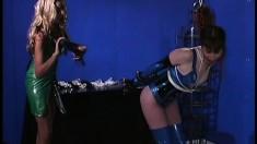 Mistress puts her bound pain slut through a hair pulling torture
