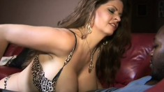 Big breasted June Summers is eager to suck on her lover's black piston