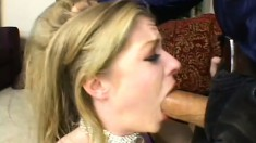 Pretty blonde deep throats a long prick and gets a mouthful of sperm