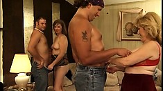 Mature bisexual ladies do each other before two studs come in to drill them