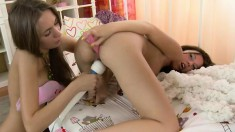 Young beauties Debbie and Sharron get together on the bed and have fun with sex toys