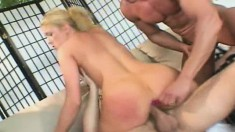 Fine blonde babe gets her holes drilled during a bareback threesome