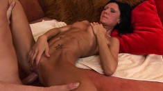 Slim brunette Susanne moans while getting penetrated by a thick dong